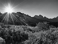 (Thumbnail showing black and white mountains and sun)