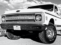 (Thumbnail of black and white photo of front of a white truck)